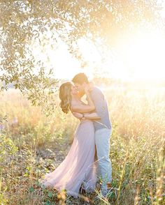 Loved frolicking through this golden sun kissed field with Alex and Jay! See more of their gorgeous engagement session on the blog!  #orlandoengagementphotographer #engaged #shesaidyes #isaidyes #anthropologie #maxidress #film #contax645 #filmisnotdead #orlando