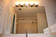 This House Is Our Home: Let There Be Light Fixtures (changing bathroom light fixtures)
