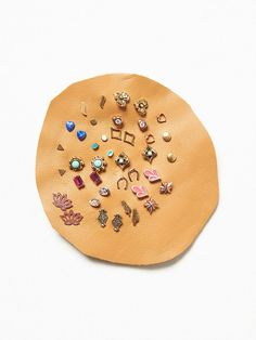Mega Stud Set   Stones, gems, and charms! These sweet studs come in quite a collection, displayed on a leather patch. Mix and match as you like.   *By Free People