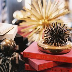 Stacking is an Art!  Layer your books in varying directions and patterns for a more dynamic display! Whitedoveinc.com