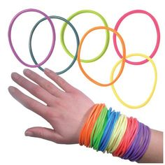 Jelly Bracelets: I had so many of these, I could have linked them ALL together and wrapped them around our house a few times.