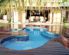 Idea on how to put a wood deck around an above ground pool.