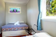 Holiday House | Russell-Orongo Bay Holiday Park.  Second Bedroom which contains a double and a single bed.