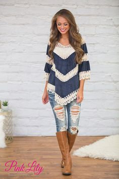 This gorgeous crochet blouse is such a beautiful addition to our fall wardrobe! We adore the navy color paired with the crocheted ivory details woven throughout - it's simply a stellar combination!