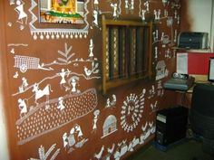 Warli painting on wall -  a story of their lifey on their wall.