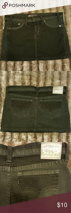 "LEVI STRAUSS Black Denim mini Skirt LEVI STRAUSS Black Denim mini Skirt   Low Twist in black dark Distressed Denim   Size states waist 26   Size 5 or 7   Approx measurements: waist 15.5"" length 12""  97%and 3% spandex Levi's Skirts Mini"