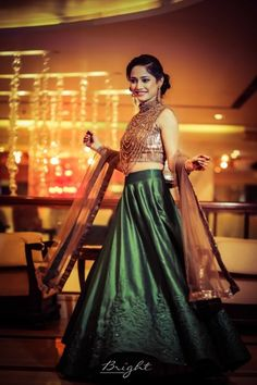 Light Lehengas - Bride in a  Olive Green Lehenga with a Bronze Blouse and Dupatta | WedMeGood | Photo by: Bright Photographers #wedmegood #indianbride #indianwedding #bridalwear #lightlehenga #green #bronze #lehenga #bridal