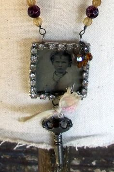 like this old tin type necklace