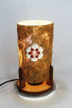 DESK LAMP Lamp shade made from cocofiber. Bottom side made from wood layered by cocopeat. Clamshell added as assecories. Dimention: H: 25 cm. D: 14 cm.
