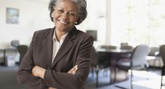 Black businesswoman smiling in office