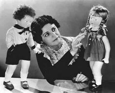 Beatrice Alexander started the Madame Alexander Doll Company in 1923. Growing up, her parents ran a doll repair shop and Alexander and her sisters began making dolls. During World War I they often made Red Cross Nurse dolls out of rags. In the 1930s Alexander became the first to make licensed characters from literature and movies into dolls. The first of these dolls were from Alice in Wonderland, Little Women, and Gone with the Wind.