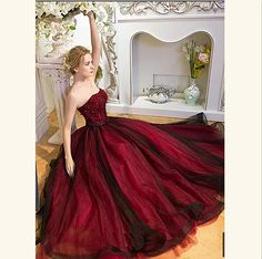 Burgundy long beaded A-line lace up prom dress