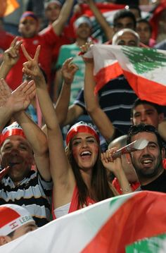 A Lebanese football fan flashed sign for victory as she support her national team during their 2014 World Cup Asian