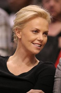 Charlize Therons casual, updo hairstyle