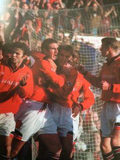 Eric Cantona celebrates during his comeback vs Liverpool