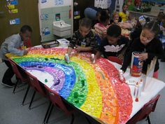 Rainbow colors collage - The kids found random pieces of broken toys and left over art scraps and made a 3-D rainbow!