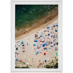 This colorful image of 'Montauk, Point Beach' was taken by American photographer Gray Malin as part of his 'À la Plage' series. The series, which was shot from a doorless helicopter, provides a bird's eye perspective of colorful umbrellas on a sandy beach with green water in the background - a recurring feature in Malin's work. The viewer sees this landscape and its figures as repetitive with abstract forms and colors that celebrate beauty in the natural world. This it...