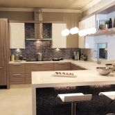 This urban kitchen design features gray textured foil cabinets from Dura Supreme Cabinetry.  Kitchen Design by Kitchens of Diablo. – Find more ideas like this at DuraSupreme.com    #urbanstyle #urbankitchen #urbanloft #loft #durasupreme