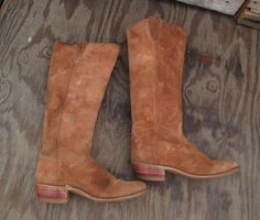 Vintage knee high cowboy boots are yummy brown suede with patina and they are fantastic. Vintage 70s cowboy boots are just so cool. You dont see