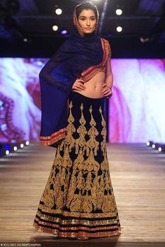 Beautifully embellished blue lengha by Monisha Jaising