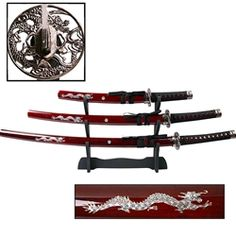 This three piece samurai sword set includes a Japanese Katana, Wakizashi and Tanto. Set features a white dragon painted on the wooden saya (scabbards). Black cord wrapped handles, metal tsuba (guards) and a wooden display stand complete this attractive set.