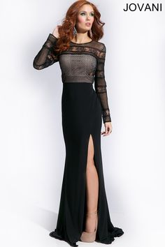 Long Sleeve Jersey Dress 21796: Stunning black long sleeve jersey dress features a netted and lace bodice. #prom