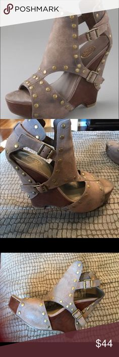 Ash Lovely Distressed Suede Platform Wedge Sandal Pre-owned Ash Sandals. Sandals are distresssed with grommets around suede and double buckles on side. Super cute and fashionable.  Only signs of wear are on sole. Heel measures 5 inches platform measures 1 inch. Ash Shoes Wedges