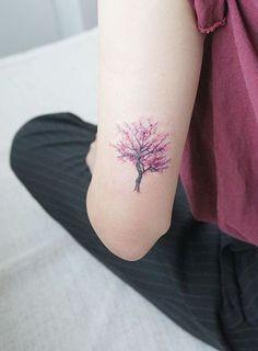 Back of Arm Cherry Blossom Tree Tattoo Ideas at MyBodiArt.com #TattooIdeasArm