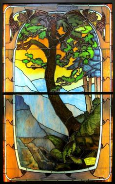 Jacques Gruber (1870-1936) - Paysages des Vosages Leaded Glass Window. Multi-Layered Painted & Etched Coloured Glass with Lead Came and Wood Frame. Nancy, France. Circa 1903.