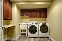 Basement renovation laundry wood cabinets countertop
