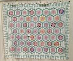 1930s Antique Quilt with Grandmother's flower garden offered by QuiltsUnlimitedOfVA.  Ice cream cone border.
