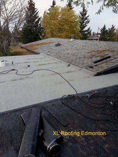 Edmonton roofing contractors - Here we are torching down the final membrane on the 2 ply SBS system. As you can see #XLRoofing flat roof system ties into the shingles and goes up about 3' to prevent any ice damming concerns. Loydminster roofing, Edmonton roofing, Edmonton roofing company, Edmonton roofing contractor, roofing  companies Edmonton, roofing contractors Edmonton, Edmonton roofing companies, Edmonton Roof Snow Removal