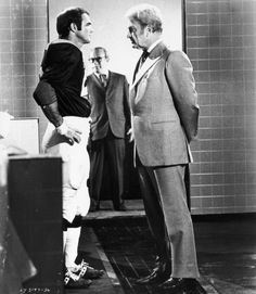 Still of Burt Reynolds and Eddie Albert in The Longest Yard  A little reminder for the quarterback before he leads the inmates' team against the prison guards.