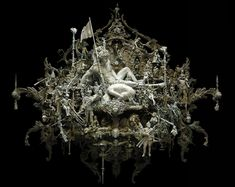 The lighting the detail and the shape.  Black background but with a somewhat creepy twist. - kris kuksi: modern rococo sculpture