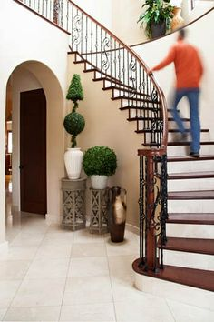 Sleek Stairway- simple way to decorate that odd space around your spiral staircase. http://www.simplystunningspaces.net