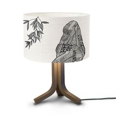 This gorgeous ByMarie Gorilla lampshade has been screen printed onto 100% cotton off white fabric with black detail. The front shows the gorilla's head and body and around the side shows a branch of bamboo.  This shade can be made as a ceiling shade or a shade to stand on a base, please request when placing your order how you would like your shade to be made.  Each shade is fitted with a standard 40mm UK and european fitting which is also fitted with a 25mm converter plug. (Simply remove…