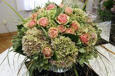 Panicum grass accent in hydrangea and roses.