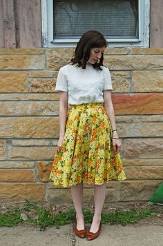 Floral skirt with white blouse.