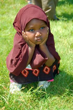 A little Somali girl.   Very sweet. Would have removed the stuff in the background in photoshop though to make it even better...