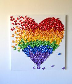Amazing collage of paper butterflies formed into a heart shape. Combining the colors of the rainbow give an impression of freedom in love and equality. The butterflies also look as if they're bursting out from the side of the heart on to freedom of expression.