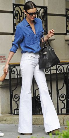 Miranda Kerr nails the denim-on-denim look with inspired high waisted flared white denim. Denim On Denim Looks, Looks Jeans, Denim Top, Denim Jeans, Chambray Top, Women's Denim Style, Denim Shirts, Jeans Fit, Jeans Pants