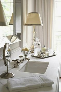 When space allows, decorative details that make the bath feel as accessorized and beautiful as the rest of the house are a must! This lovely lamp and tray are inspiring us!
