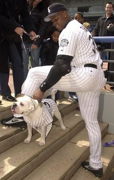 """Frank Thomas  Frank Thomas pets his dogs Bubba and Barbie during the """"Dog Day"""" promotion at Comiskey Park."""