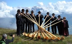 A group of alphorn players perform during the 11th international alphorn festival in Nendaz, south western Switzerland