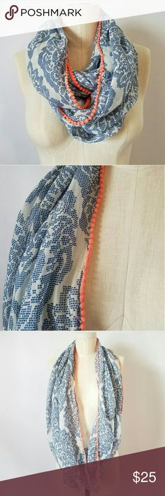 Summer Infinity Scarf Love this lightweight scarf ?? Blue and white floral pattern with peach colored pom pom trim Excellent gently used condition!  PLEASE READ CLOSET INFO AND POLICIES POST Accessories Scarves & Wraps