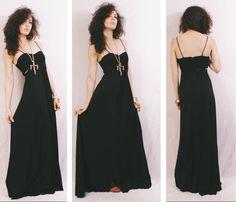 Vtg 70s Black Slinky Disco Goddess Cutout Maxi Evening Dress by MoveBabyVintage on Etsy https://www.etsy.com/listing/477008697/vtg-70s-black-slinky-disco-goddess