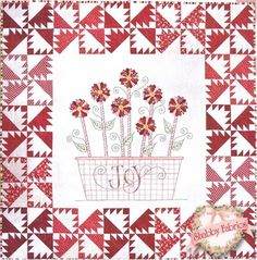 "Joyful Poinsettias: Bring a basket of joyful poinsettias into your home this holiday season!  Pattern includes all instructions to create this 60"" x 60"" quilt which features piecing, applique, hand embroidery, and fabric tinting.  Add the .005 Red Micron pen below to mark your stitch lines."
