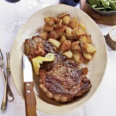 Grilled Rib-Eye Steaks with Roasted Rosemary Potatoes | Food & Wine