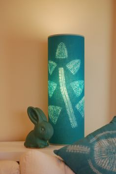 Shibori lamp shade in a fern design dyed with procion, created by Annabel Wilson