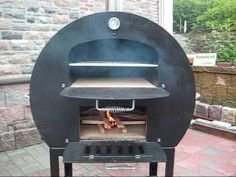 I've designed and built a half wood fired pizza oven, half conventional BBQ, all based around an oil drum and a whole load of steel stock. Portable Pizza Oven, Diy Pizza Oven, Brick Oven Pizza, Pizza Ovens, Wood Oven, Wood Fired Oven, Wood Fired Pizza, Bbq Wood, Brick Oven Outdoor